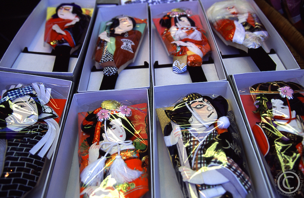 Traditional badminton paddles with fancy decorations of geisha and samurai now sold as souvenirs at Senso-Ji shrine, Asakusa, Tokyo, Japan