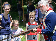 Kent Snell (R) of the Second Pennsylvania Regiment shows, from left, Wendy Thompson, Shannon Thompson, 6, and Jack Thompson, 9, the proper use of a bayonet during the Hatboro Tricentennial celebration at Pennypack Elementary School Saturday June 13, 2015 in Hatboro, Pennsylvania.  (Photo by William Thomas Cain/Cain Images)