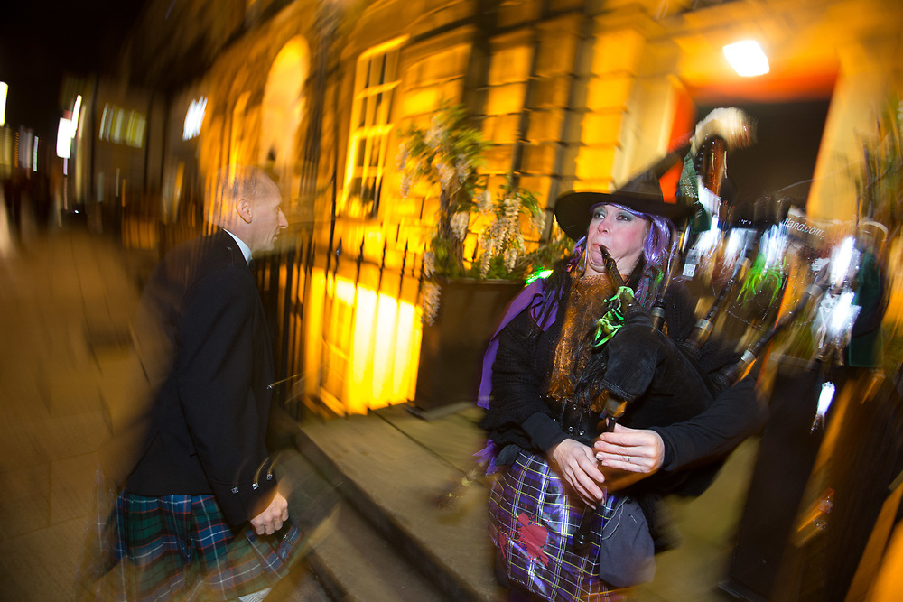 Photographing charity Halloween event in Edinburgh, guest being piped in.