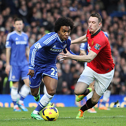 Chelsea's Willian fends off Man Utd's Phil Jones during the English Barclays Premiership match between Chelsea FC and Manchester United FC at Stamford Bridge, London, 19th January 2014 © Phil Duncan | SportPix.org.uk