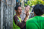 Rimbang Baling Wildlife Sanctuary, Sumatra, Indonesia, August 2017. WWF  tiger research programme coordinator Febri A. Widodo and a volunteer interview a local man who saw a tiger. International volunteers of Biosphere Expeditions work together with local scientists of the WWF project to  protect the Sumatran Tiger. The 'citizen scientists' survey the rainforest on foot and in boats, looking for tracks, kills, scats and the animals themselves, and setting camera traps. They also work with local people on capacity-building and creating local incentives for tiger conservation. All this in an effort to mitigate human-wildlife conflict and create strategies to ensure the survival of the critically endangered Sumatran tiger into the future. Photo by Frits Meyst / MeystPhoto.com