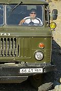 GOBI DESERT, MONGOLIA..08/29/2001.Near Mount Burkhan Khailaast. The cook steering the 4x4 kitchen truck of Nomads Tours..(Photo by Heimo Aga).
