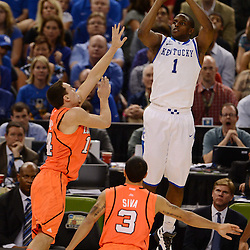 Mar 31, 2012; New Orleans, LA, USA; Kentucky Wildcats guard Darius Miller (1) shoots as Louisville Cardinals guard/forward Kyle Kuric (14) defends during the second half in the semifinals of the 2012 NCAA men's basketball Final Four at the Mercedes-Benz Superdome. Mandatory Credit: Derick E. Hingle-US PRESSWIRE