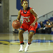 St. John's Guard Briana Brown (12) dribbles the ball up court in the second half of a NCAA regular season non-conference game between Delaware (CAA) and St. John's (Big East) Monday, Dec 30, 2013 at The Bob Carpenter Sports Convocation Center in Newark Delaware.