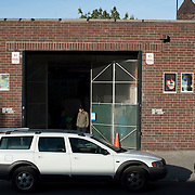 """October 14, 2012 - New York, NY : People emerge from a warehouse-like arts space on 7th Avenue in Brooklyn on Saturday afternoon during """"Gowanus Open Studios"""". CREDIT: Karsten Moran for The New York Times"""