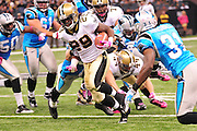 "New Orleans Saints RB Chris Ivory breaks a tackle during the game against the Carolina Panthers Sunday Oct. 3,2010. The NFL has gone ""Pink"" for October in honor of Breast Cancer Awareness. The Saints went on to win 16-14. John Carney kicked three field goals to help the Saints win. PHOTO©SuziAltman.com"