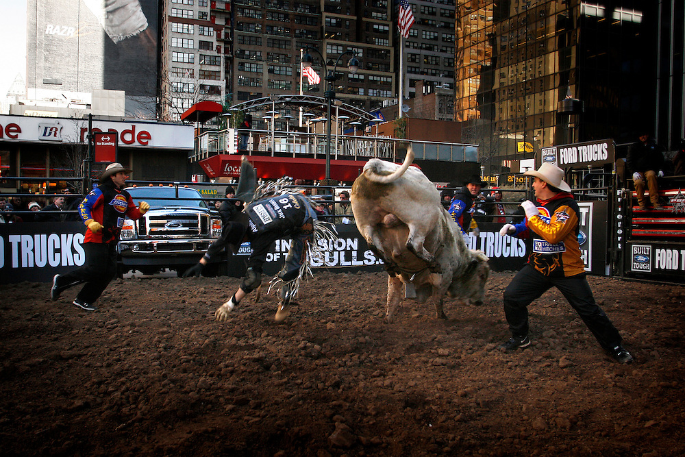 Bull rider Bow Hill rides a bull for a eight seconds to record a score of 90 during the Professional Bull Riders Invasion outside Madison Square Garden Thursday, Jan. 3, 2008, in New York. ....