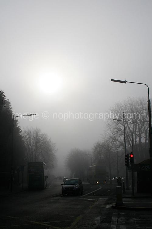 Foggy weather and early morning traffic in ballsbridge Dublin Ireland