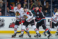 KELOWNA, CANADA - OCTOBER 20: Kyle Topping #24 of the Kelowna Rockets checks Conor MacEachern #4 of the Portland Winterhawks on October 20, 2017 at Prospera Place in Kelowna, British Columbia, Canada.  (Photo by Marissa Baecker/Shoot the Breeze)  *** Local Caption ***