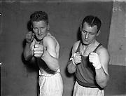 National Junior Boxing Championships.18/12/1952<br /> T. Hehir (Kilkenny) (right) Light/heavyweight winner.<br /> On left T. Murphy (New Ross) Light/heavyweight runner up.