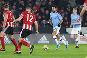 Riyad Mahrez and Kevin De Bruyne attack during the Premier League match between Sheffield United and Manchester City at Bramall Lane, Sheffield, England on 21 January 2020.