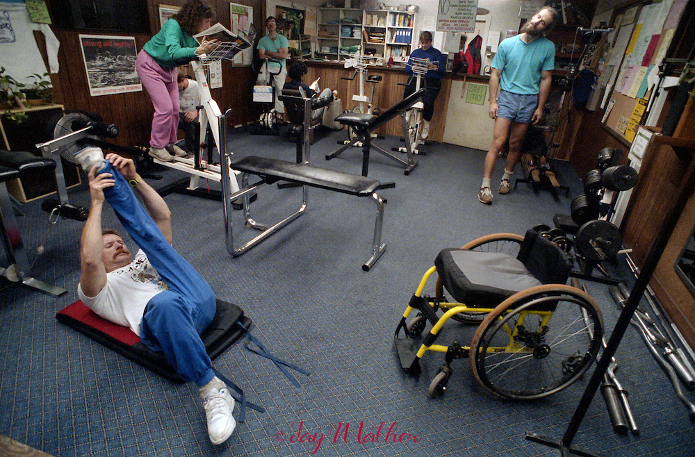 Mark Wellman, a Yosemite National Park ranger and first paraplegic climber to scale El Capitan, continues his training regimen at the park employee weight room, January 1990.  He and his climbing partner would later complete a climb of Half Dome in September 1991.