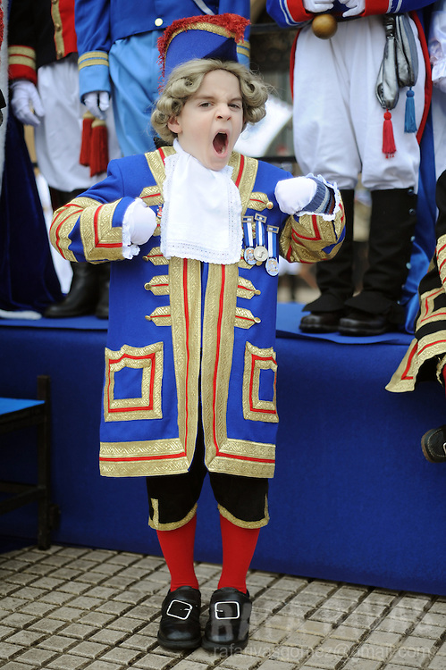 A child yawns as he takes part in San Sebastian's Tamborrada. Some thousands soldiers-clad children march and play drums, on January 20, 2010, during a parade to celebrate San Sebastian's day, the northern Spanish Basque city of San Sebastian's main feast. PHOTO / RAFA RIVAS