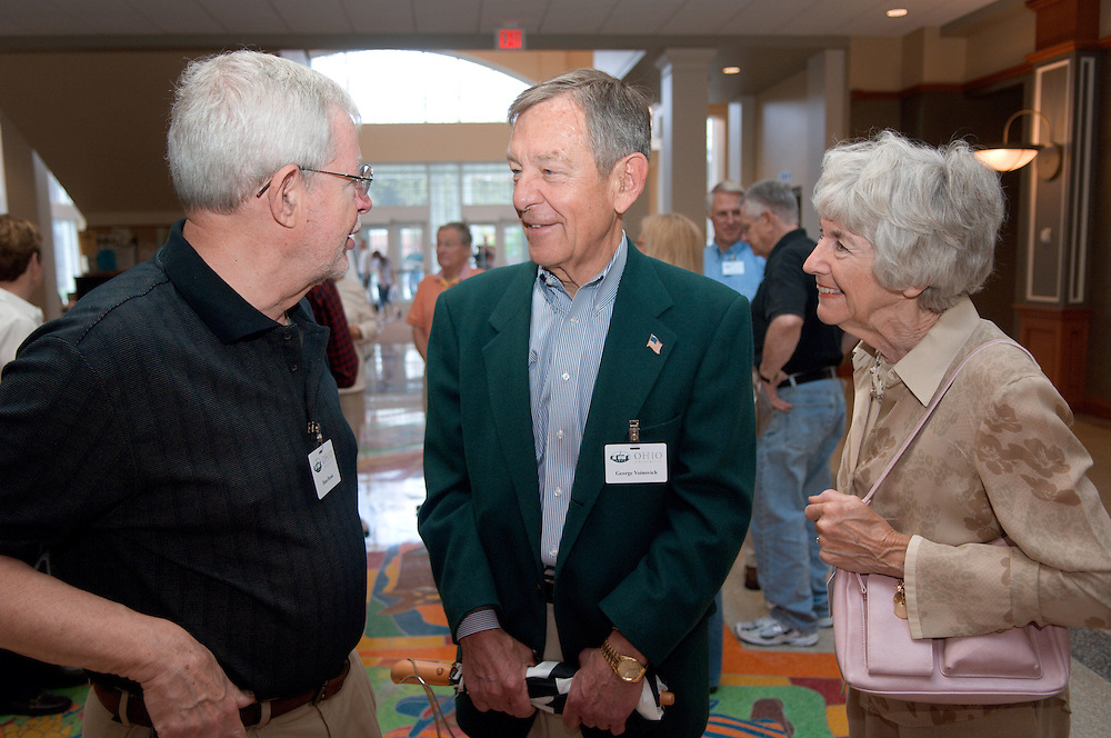18660Golden Reunion, class of 1958: Tour of Baker Center..Senator George Voinovich  & Mrs. Voinovich talk to Dean Braun
