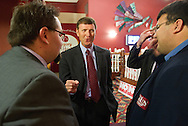 Bob Vander Plaats (center) talks with supporters at the Iowa For Freedom watch party held at Comfort Suites in Urbandale, Iowa on Tuesday November 2, 2010. Iowa for Freedom was urging people to vote against the three Supreme Court Justices up for retention. (Stephen Mally for The New York Times)