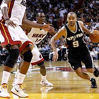 17 January 2012: San Antonio Spurs point guard Tony Parker (9) drives past Miami Heat guard Terrel Haris (14) during the Miami Heat 120-98 victory over the San Antonio Spurs at the AmericanAirlines Arena, Miami, Florida, USA.