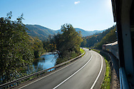 View from a moving train running parallel to a highway near Banja Luka, Bosnia and Herzegovina