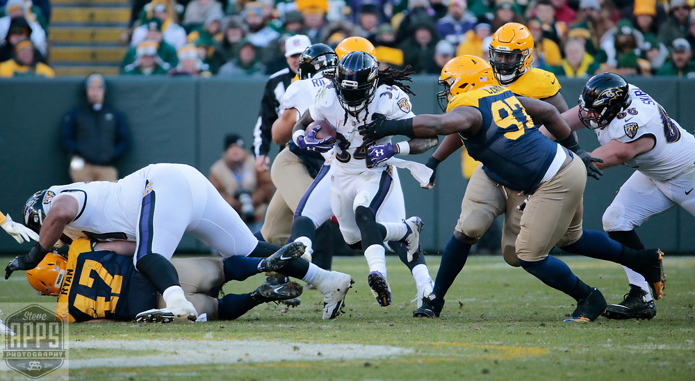 Baltimore Ravens running back Alex Collins (34) for 9-yards in the 4th quarter. <br /> The Green Bay Packers hosted the Baltimore Ravens at Lambeau Field Sunday, Nov. 19, 2017. The Packers lost 23-0. STEVE APPS FOR THE STATE JOURNAL.