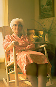 Elderly grandmother age 85 in rocking chair in her house.  Clitherall  Minnesota USA