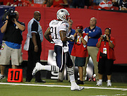 ATLANTA - AUGUST 19:  Running back Fred Taylor #21 of the New England Patriots runs for a first quarter touchdown during the preseason game against the Atlanta Falcons at the Georgia Dome on August 19, 2010 in Atlanta, Georgia.  (Photo by Mike Zarrilli/Getty Images)