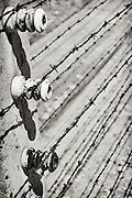 Electrified barbed wire fence at the World War 2 Nazi concentration and extermination Camp Auschwitz, in occupied Poland.