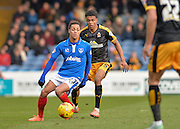 Portsmouth midfielder Kyle Bennett holds off Cambridge United Defender Darnell Furlong during the Sky Bet League 2 match between Portsmouth and Cambridge United at Fratton Park, Portsmouth, England on 27 February 2016. Photo by Adam Rivers.