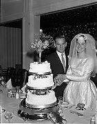 28/07/1962<br /> 07/28/1962<br /> 28 July 1962 <br /> Wedding of Mr Desmond F. English, Landscape Cresent, Churchtown and Miss Blanche O'Brien Oakley Park, Blackrock at St John the Baptist Church, Blackrock and Ross's Hotel Dun Laoghaire, Dublin. Image shows the bride and groom cutting the wedding cake in the hotel.