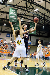 19 March 2010: Carrie Snikkers shoots from under the arms of Amy Woods. The Flying Dutch of Hope College defeat the Yellowjackets of the University of Rochester in the semi-final round of the Division 3 Women's Basketball Championship by a score of 86-75 at the Shirk Center at Illinois Wesleyan in Bloomington Illinois.