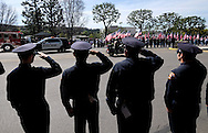 Police and firefighters salute as a police motorcade to honor Whittier Police Officer Keith Boyer arrives at Rose Hills Memorial Park in Whittier, Calif., Friday, March 3, 2017. Boyer, who was fatally shot after responding to a traffic crash, was remembered today by thousands of law enforcement officers, friends and family as a dedicated public servant, talented drummer, loving friend and even a ``goofy'' dad.(Photo by Ringo Chiu/PHOTOFORMULA.com)<br />