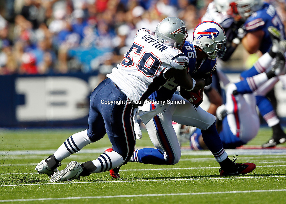 New England Patriots outside linebacker Gary Guyton (59) tackles Buffalo Bills wide receiver David Nelson (86) during the NFL week 3 football game against the Buffalo Bills on Sunday, September 25, 2011 in Orchard Park, New York. The Bills won the game 34-31. ©Paul Anthony Spinelli