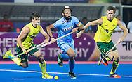 BHUBANESWAR (India) -  Hero Champions Trophy hockey men. Match for bronze. Australia vs India. Sardar Singh of India between Matt Gohdes of Australia (l) and Tristan White of Australia. Photo Koen Suyk