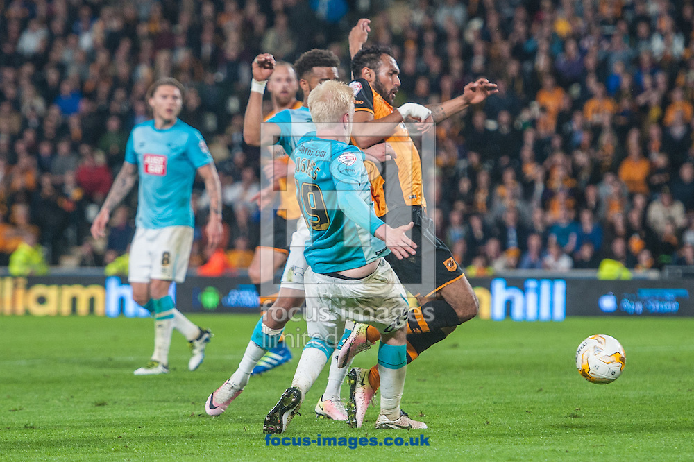 Ahmed Elmohamady of Hull City goes down under a challenge from Will Hughes of Derby County during the Sky Bet Championship Playoff Semi-final Leg Two at KC Stadium, Hull<br /> Picture by Matt Wilkinson/Focus Images Ltd 07814 960751<br /> 17/05/2016