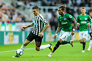 Joselu (#21) of Newcastle United on the ball pursued by Gaetan Bong (#3) of Brighton & Hove Albion during the Premier League match between Newcastle United and Brighton and Hove Albion at St. James's Park, Newcastle, England on 20 October 2018.