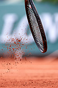 Paris, France - 2017 June 03: Tennis rocket and the clay during women's single match third round  during tennis Grand Slam tournament The French Open 2017 (also called Roland Garros) at Stade Roland Garros on June 03, 2017 in Paris, France.<br /> <br /> Mandatory credit:<br /> Photo by &copy; Adam Nurkiewicz<br /> <br /> Adam Nurkiewicz declares that he has no rights to the image of people at the photographs of his authorship.<br /> <br /> Picture also available in RAW (NEF) or TIFF format on special request.<br /> <br /> Any editorial, commercial or promotional use requires written permission from the author of image.