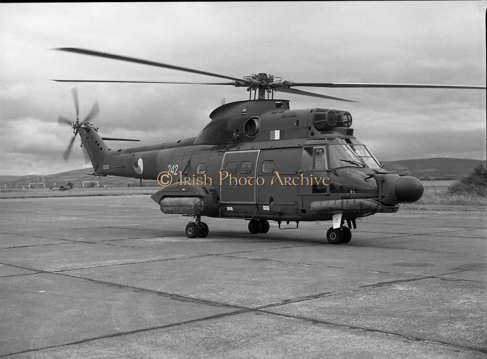 """Air Corps Takes Delivery Of Puma Helicoptor. (N86)..1981..22.07.1981..07.22.1981..22nd July 1981..The Air Corps took delivery,today, of a new French Built SA 330 J """"Puma"""" Helicoptor. The """"Puma"""" escorted by another Air Corps helicoptor landed at Casement Aerodrome, Baldonnell,Co Dublin...Image shows the """"Puma"""" taxiing along the tarmac at Casement Aerodrome after landing."""