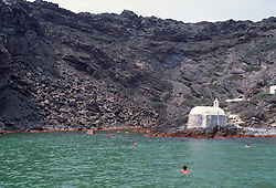 Swimmers in Santorini, Greece