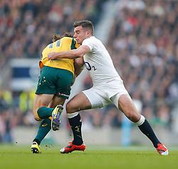 Australia Winger Rob Horne is tackled by England Fly-Half George Ford - Photo mandatory by-line: Rogan Thomson/JMP - 07966 386802 - 29/11/2014 - SPORT - RUGBY UNION - London, England - Twickenham Stadium - England v Australia - QBE Autumn Internationals.