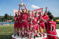 NEWTOWN, WALES - Sunday, May 6, 2018: Nathan Woolfe of Connahs Quay Nomads sprays champagne as captain George Horan lifts the Welsh Cup following a 4-1 victory in the FAW Welsh Cup Final between Aberystwyth Town and Connahs Quay Nomads at Latham Park. (Pic by Paul Greenwood/Propaganda)