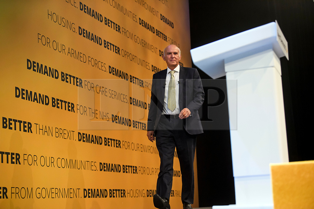 © Licensed to London News Pictures. 18/09/2018. Brighton, UK.  Liberal Democrat leader VINCE CABLE arrives on stage to deliver his leaders speech on the final day of the Liberal Democrat Autumn Conference in Brighton, East Sussex on September 18, 2018. This years event has been mainly focused around Brexit, the UK's departure from the EU. Photo credit: Ben Cawthra/LNP