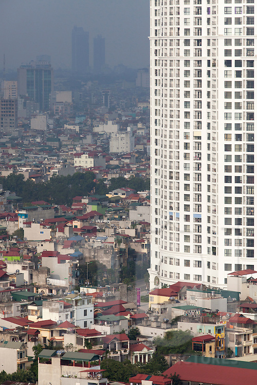 Royal City emerging from an old housing area in Thanh Xuan, Hanoi, Vietnam. It is a Vincom group project created in 2013 consisting of a complex of 5 towers housing luxury apartments and offices as well as the largest underground mall in South East Asia.