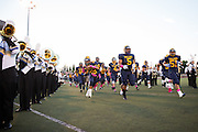 The Trojans rush the field before the Homecoming game against Saratoga at Milpitas High School in Milpitas, California, on October 10, 2014. Milpitas beat Saratoga 49-0. (Stan Olszewski/SOSKIphoto)
