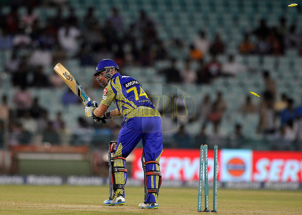 Stiaan van Zyl of Cape Cobras looks back as he gets bowled out by Trent Boult of Northern Knights during match 3 of the Oppo Champions League Twenty20 between the Cape Cobras and the Northern Knights held at the Chhattisgarh International Cricket Stadium, Raipur, India on the 19th September 2014<br /> <br /> Photo by:  Pal Pillai / Sportzpics/ CLT20<br /> <br /> <br /> Image use is subject to the terms and conditions as laid out by the BCCI/ CLT20.  The terms and conditions can be downloaded here:<br /> <br /> http://sportzpics.photoshelter.com/gallery/CLT20-Image-Terms-and-Conditions-2014/G0000IfNJn535VPU/C0000QhhKadWcjYs