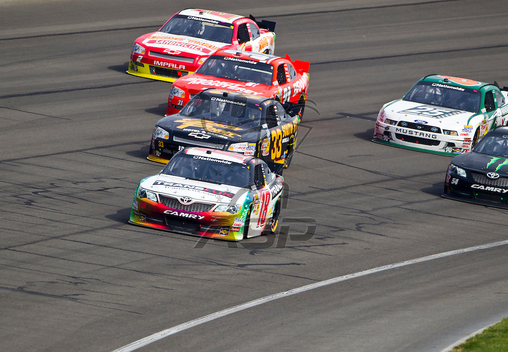 FONTANA, CA - MAR 24, 2012:  Joey Logano (18) holds off a hard charging field to win the Royal Purple 300 Nationwide race at the Auto Club Speedway in Fontana, CA.