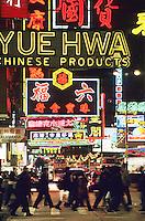 Neon signs and pedestrians, Tsim Sha Shui, Hong Kong, China..