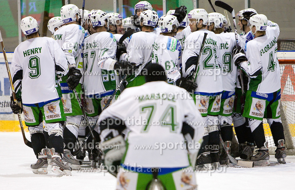 Olimpija celebrates after the 28th Round  ice hockey match of EBEL league between HK Acroni Jesenice and HDD Tilia Olimpija Ljubljana, on December 4, 2009, in Arena Podmezaklja, Jesenice, Slovenia. Olimpija defeated Jesenice 8-7. (Photo by Vid Ponikvar / Sportida)