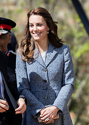 HAMPTON COURT - UK  - 4th May 2016:  The Duchess of Cambridge officially opens the new Magic Garden at Hampton Court Palace , East Molesey. Part of the Historic Royal Palaces, Hampton Court Palace sits on the banks of the rover Thanes and is famous for its ornate gardens.<br /> Kate wore a Light Blue/Grey coat.<br />  Photo Ian Jones