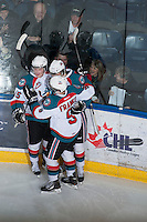 KELOWNA, CANADA - JANUARY 16: The Kelowna Rockets celebrate a goal against the Spokane Chiefs at the Kelowna Rockets on January 16, 2013 at Prospera Place in Kelowna, British Columbia, Canada (Photo by Marissa Baecker/Shoot the Breeze) *** Local Caption ***