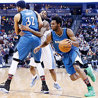 15 February 2017: Minnesota Timberwolves forward Andrew Wiggins (22) drives past Denver Nuggets guard Will Barton (5) on a screen by Minnesota Timberwolves center Karl-Anthony Towns (32) during the Minnesota Timberwolves 112-99 victory over the Denver Nuggets, at the Pepsi Center, Denver, Colorado, USA.