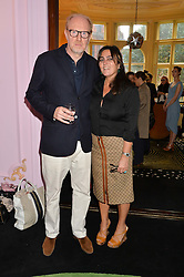 SOLANGE AZAGURY-PARTRIDGE and her husband MURRAY PARTRIDGE at a lunch to view Solange Azagury-Partridge's new collection - Chromance at her store at 5 Carlos Place, London on 7th October 2014.
