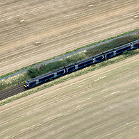 An aerial view of a Scotrail train heading south from Perth to Glasgow near Gleneagles<br />Picture by Graeme Hart.<br />Copyright Perthshire Picture Agency<br />Tel: 01738 623350  Mobile: 07990 594431